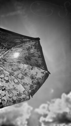 umbrella clouds sun sky blackandwhite